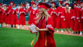Northwestern Regional High School graduate Victoria Guilmette is all smiles after receiving her diploma during graduation ceremonies Wednesday at Dunkin' Donuts Park in Hartford. Jim Shannon Republican American