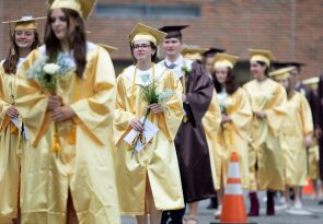 Graduates march into their ceremony at the school in Thomaston Wednesday. Steven Valenti Republican-American
