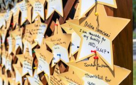 Students were encouraged to post a stat for what they were thankful for as part of graduation ceremonies Friday at Oliver Wolcott Technical High School in Torrington. Jim Shannon Republican American