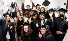 Graduates celebrate during their ceremony at Kaynor Tech High School in Waterbury Friday. Steven Valenti Republican-American