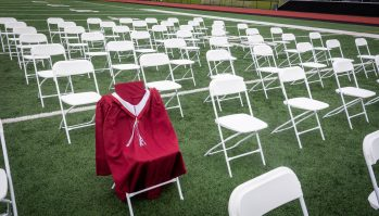 A robe was placed on a chair to remember Torrington High School student Kristopher Gomez during graduation ceremonies on the Torrington High School football field on Friday. Gomes was a junior and only 16-years-old when died in 2020 after suffering a stroke. Jim Shannon Republican American