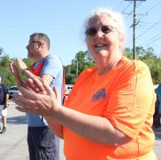 Beth Murphy, president of the board of directors of the Litchfield Hills Road Race, cheers as the race gets underway on Sunday. John McKenna Photo