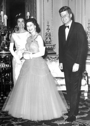 FILE - In this file photo dated June 5, 1961, Queen Elizabeth II, center, walks with U.S. President John F. Kennedy, right, and his wife Jacqueline Kennedy, as they enter an ante-room in Buckingham Palace, London, before a dinner given by the Queen in honour of the visiting President and his wife. (AP Photo, File)