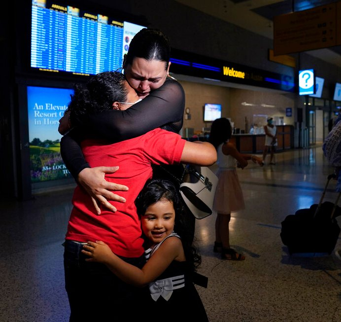 Emely, left, is reunited with her mother, Glenda Valdez and sister, Zuri, at the Austin-Bergstrom International Airport, Sunday, June 6, 2021, in Austin, Texas. It had been six years since Valdez said goodbye to her daughter Emely in Honduras. Then, last month, she caught a glimpse of a televised Associated Press photo of a little girl in a red hoodie and knew that Emely had made the trip alone into the United States. On Sunday, the child was returned to her mother's custody. (AP Photo/Eric Gay)