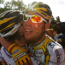 FILE - In this July 26, 2009 file photo, Mark Cavendish of Britain, right, is hugged by his teammate Mark Renshaw of Australia, left, after winning his 6th stage victory during the 21st stage of the Tour de France cycling race over 164 kilometers (101.9 miles) with start in Montereau-Fault-Yonne and finish in Paris, France. Mark Cavendish has saved the best for the end: matching cycling legend Eddy Merckx's record of 34 Tour de France stage wins at the twilight of his storied career. (AP Photo/Christophe Ena, File)