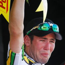 FILE - In this July 8, 2010 file photo, stage winner Mark Cavendish of Britain reacts on the podium after the fifth stage of the Tour de France cycling race over 187.5 kilometers (116.5 miles) with start in Epernay and finish in Montargis, eastern France, Thursday, July 8, 2010. Mark Cavendish has saved the best for the end: matching cycling legend Eddy Merckx's record of 34 Tour de France stage wins at the twilight of his storied career. (AP Photo/Laurent Rebours, File)