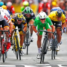FILE - In this Monday, July 4, 2016 file photo Britain's Mark Cavendish, wearing the best sprinter's green jersey, crosses the finish line ahead Germany's Andre Greipel, left, and Peter Sagan of Slovakia, wearing the overall leader's yellow jersey, to win the third stage of the Tour de France cycling race over 223.5 kilometers (138.6 miles) with start in Granville and finish in Angers, France. (AP Photo/Peter Dejong, File)