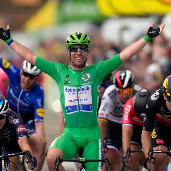 FILE - In this July 6, 2021 file photo, Britain's Mark Cavendish, wearing the best sprinter's green jersey, celebrates with teammate in background Denmark's Michael Morkov, as he crosses the finish line to win the tenth stage of the Tour de France cycling race over 190.7 kilometers (118.5 miles) with start in Albertville and finish in Valence, France, Tuesday, July 6, 2021. Mark Cavendish has saved the best for the end: matching cycling legend Eddy Merckx's record of 34 Tour de France stage wins at the twilight of his storied career. (AP Photo/Daniel Cole, File)