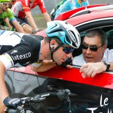 FILE - In this Tuesday, July 7, 2015 file photo Britain's Mark Cavendish talks to Tour de France winner Eddy Merckx of Belgium during the start of the fourth stage of the Tour de France cycling race over 223.5 kilometers (138.9 miles) with start in Seraing, Belgium, and finish in Cambrai, France. (AP Photo/Christophe Ena, File)