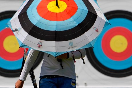 An athlete from Ukraine walks to the firing area as she practices for the 2020 Summer Olympics at Yumenoshima Park Archery Field, Sunday, July 18, 2021, in Tokyo. (AP Photo/Charlie Riedel)