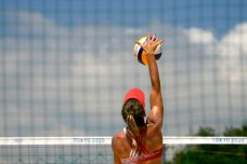 Heather Bansley, from Canada, practices during women's beach volleyball practice at the 2020 Summer Olympics, Monday, July 19, 2021, in Tokyo. (AP Photo/Charlie Riedel)