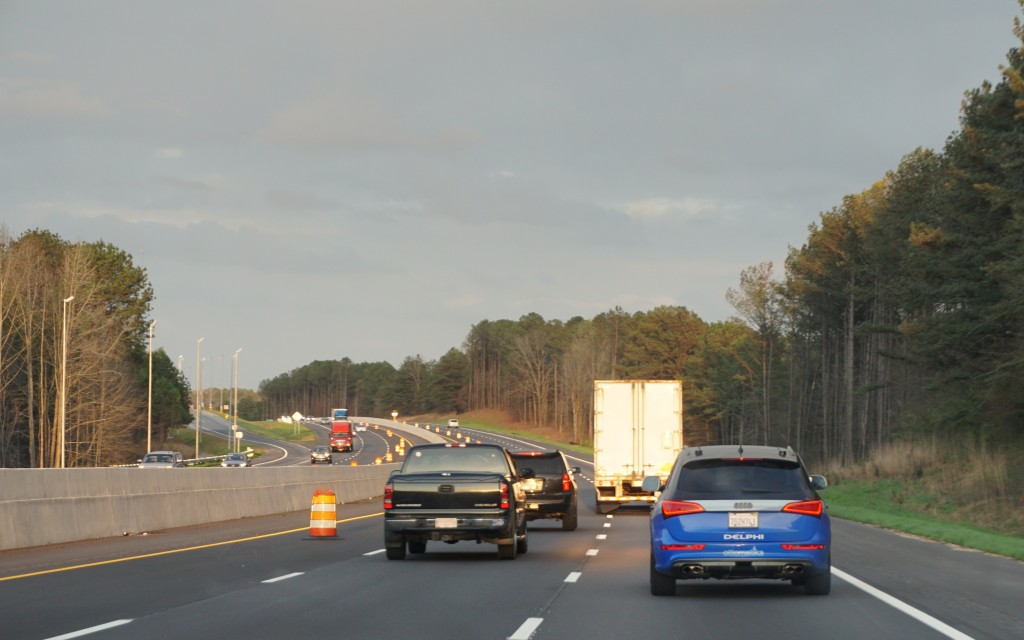A Delphi self-driving Audi, right, is tested on a highway. (Provided by Delphi)