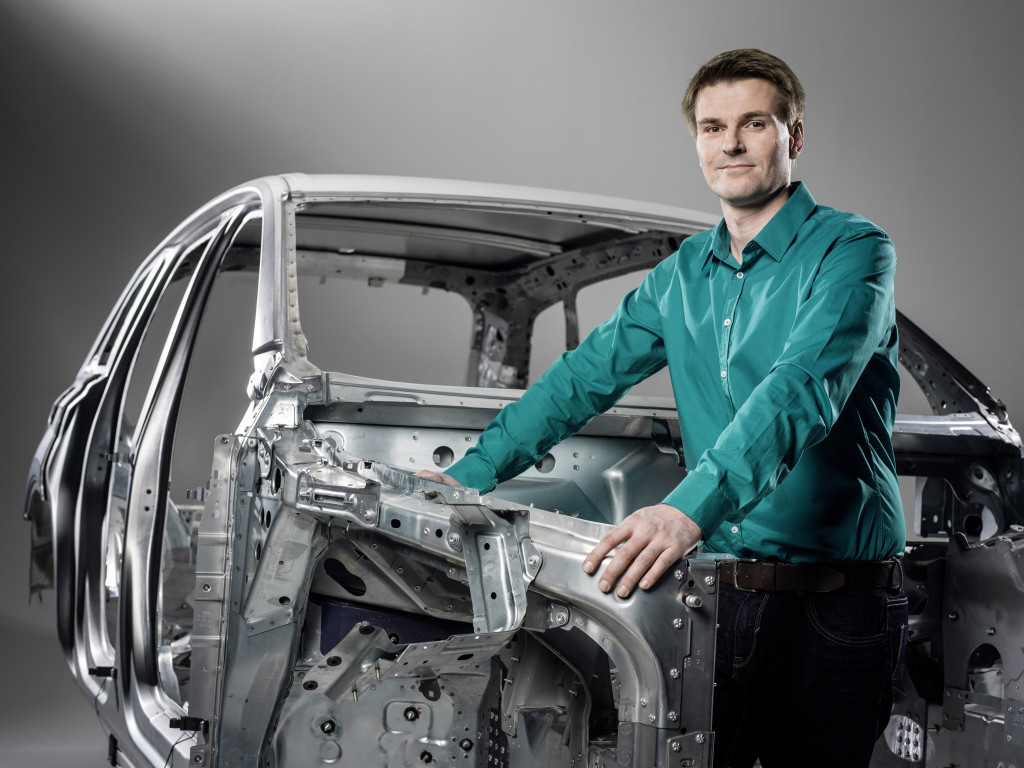 2017 Audi Q7 multimaterial body developer Hendrik Risch is shown with the Q7 body. (Provided by Audi)
