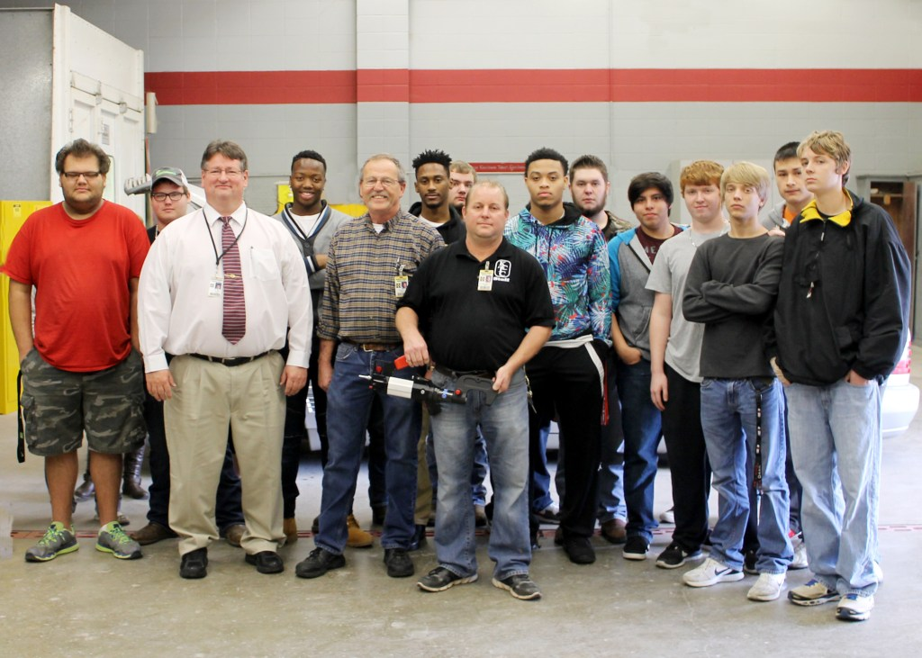 Auto collision and auto technology students and faculty at Kennett Career and Technology Center pose with the Xpress 800 rivet gun won at SEMA. Front row, from left, KCTC Director Terry Bruce, automotive technology instructor Michael Rhew and auto collision instructor Kenneth McKinney.