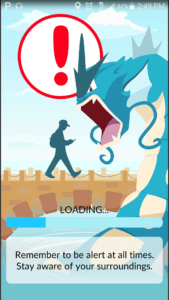 """The""""Pokémon GO"""" app warns users to pay attention while playing the augmented reality game. (Screenshot from """"Pokémon GO"""" app)"""