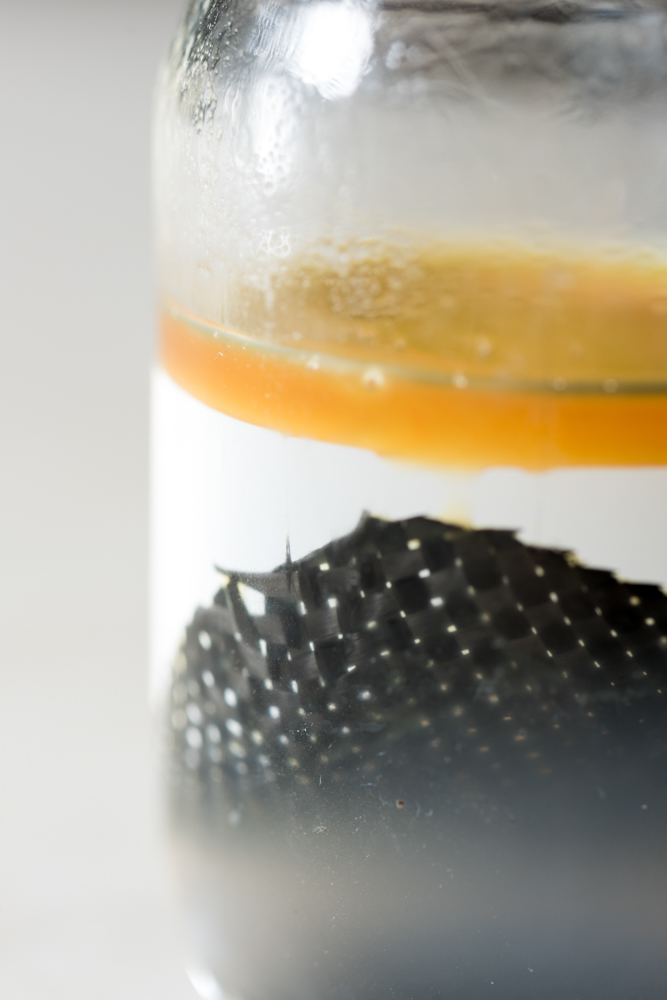 A piece of carbon fiber composite immersed in alcohol. (Rob Felt/Georgia Tech)