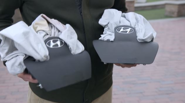 A real and counterfeit Hyundai airbag is shown in this screenshot from Hyundai video. (Screenshot of Hyundai video on YouTube)