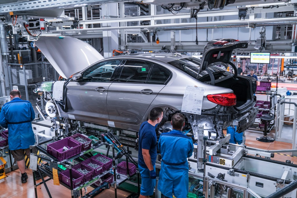 The hood and, for the first time, the entire trunk lid, on the BMW 5 Series will be made from aluminum. (Provided by BMW)