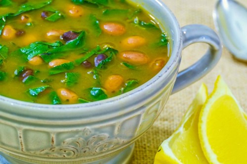 Image of a bowl full of beans and greens soup