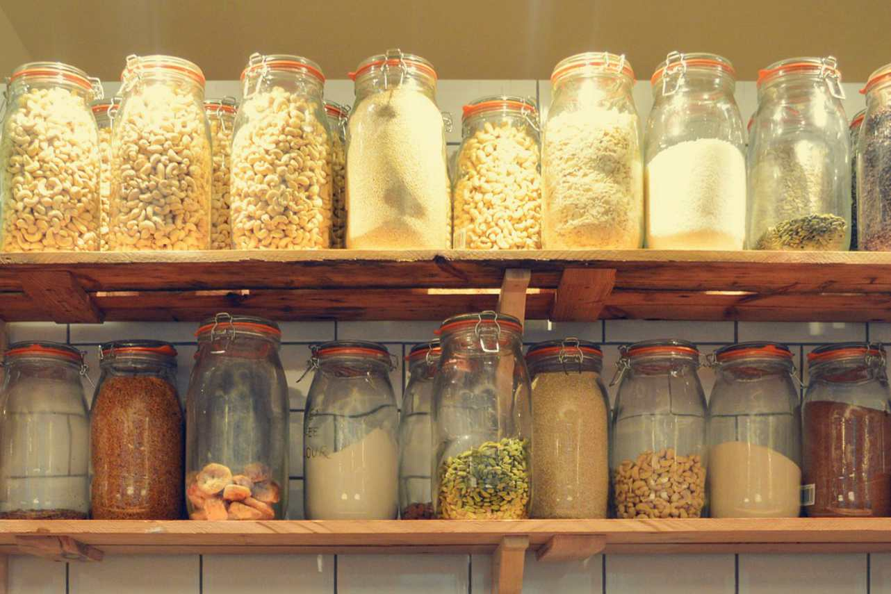 An image of jars organizing dried foods in a pantry