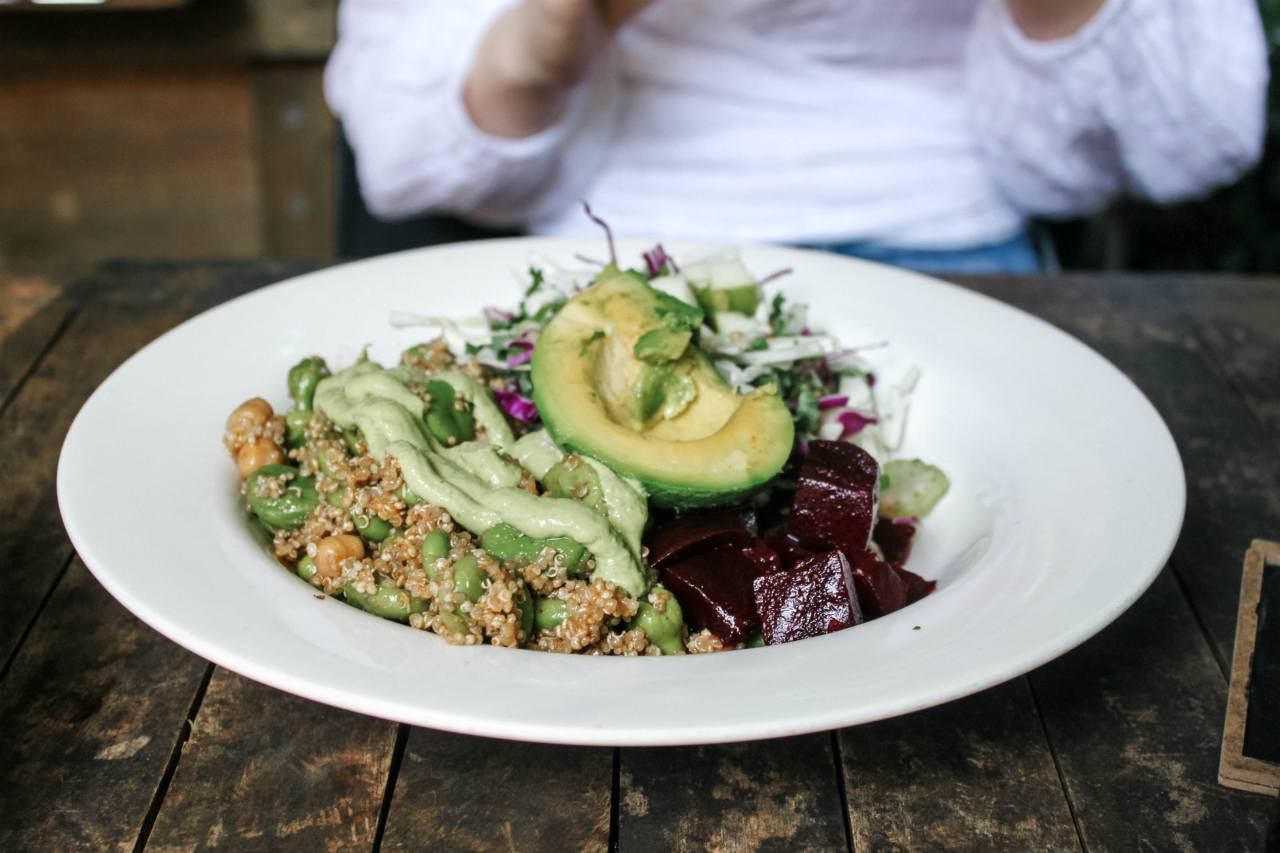 An image of a mixed vegetable bowl with avocado and quinoa