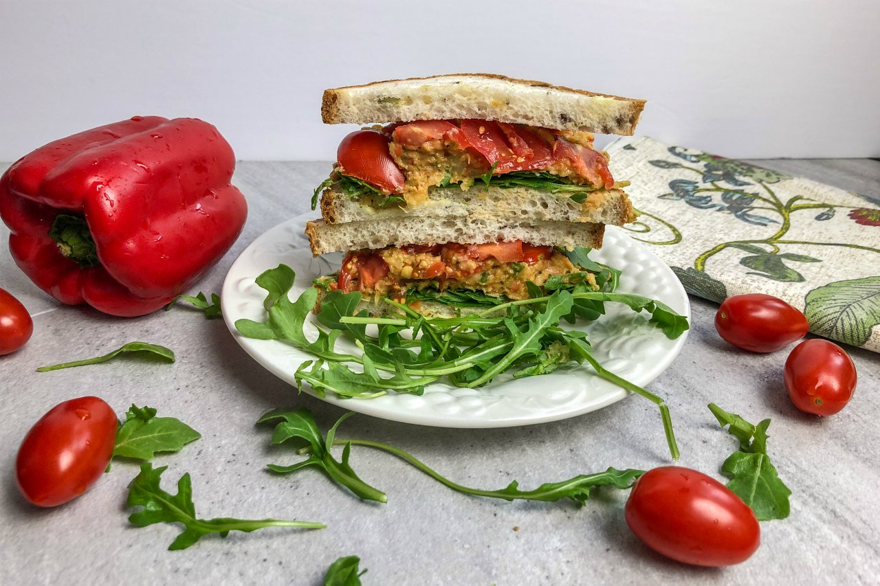 An image of a sandwich with smoky red pepper sandwich spread.