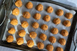 An image of a tray of uncooked Vegan Veggie Meatballs.