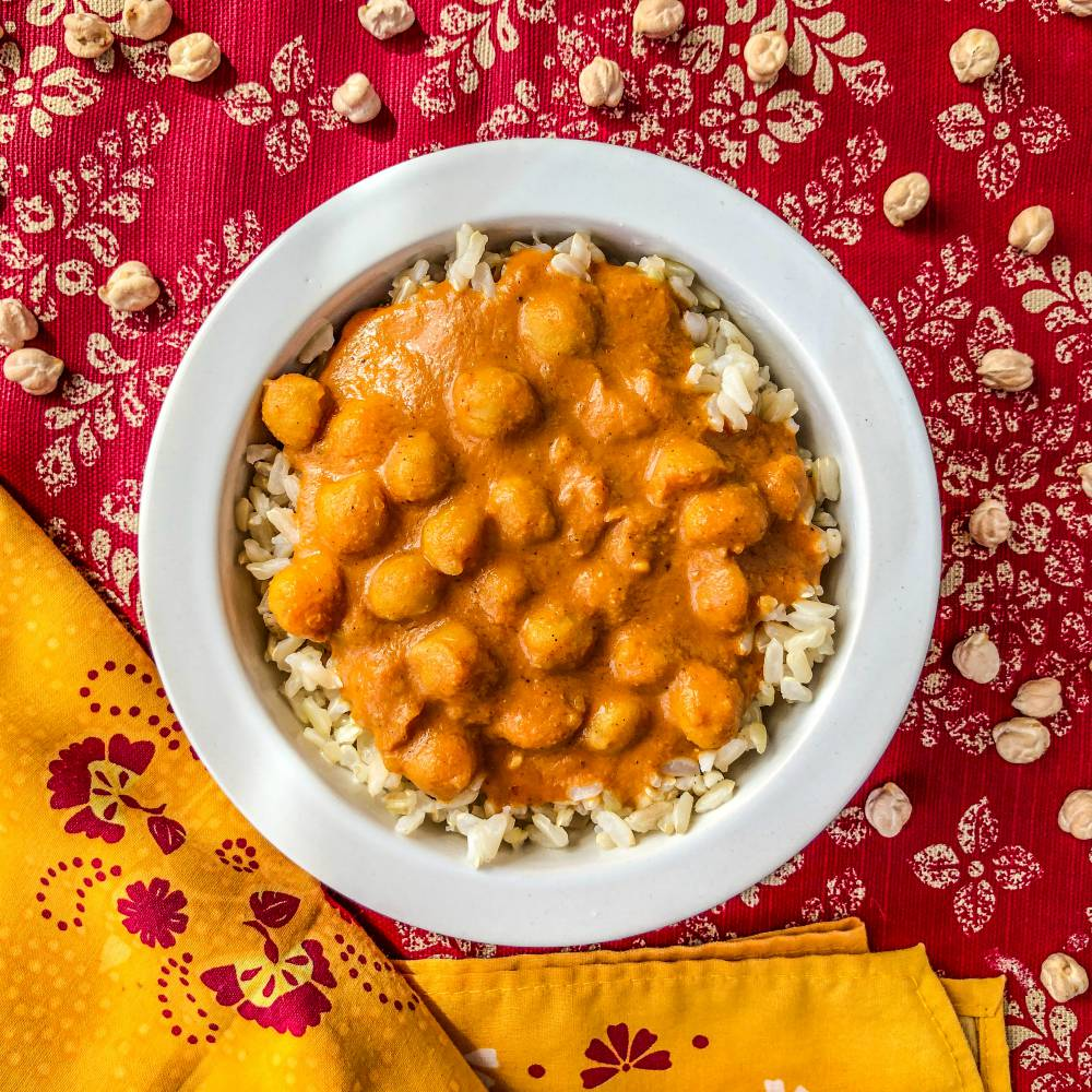 An image of a bowl of butter chickpeas and brown basmati rice.