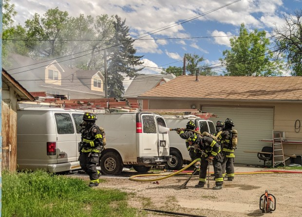 Berthoud Fire Protection District firefighters battle a vehicle fire on Saturday, May 25, in an alley between Fourth and Fifth Streets, just south of Massachusetts Avenue. (Berthoud Fire Protection District / Courtesy photo)