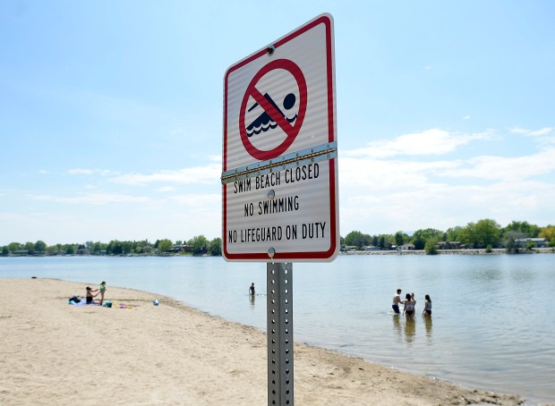 A sign warns people that the swim beach is closed Thursday at Lake Loveland. The city has not opened the swim beach yet because of the cold water. (Jenny Sparks/Loveland Reporter-Herald)