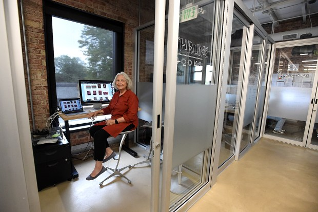Linda Ligon poses for a photo in her small office space Friday, Sept. 6, 2019, at desk chair workspace in the historic First National Bank building in downtown Loveland. Ligon, who founded Interweave Press in her home in 1975, renovated the old First National Bank building in 1990 for the company's headquarters, sold Interweave in 2005, saw it leave Loveland for Fort Collins in 2014, and now has bought back three of her early magazines: Handwoven, Spin Off and PieceWork. (Jenny Sparks/Loveland Reporter-Herald)