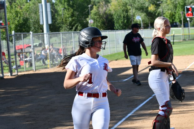 Loveland sophomore Laynee Case comes around ...