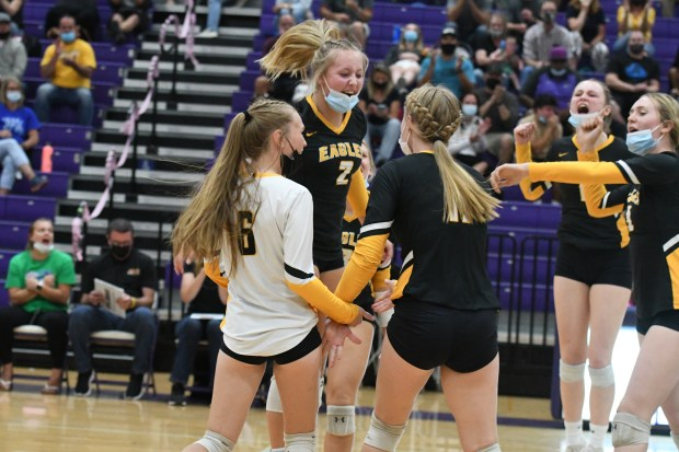 Thompson Valley volleyball players celebrate after ...