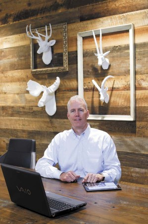 Peyton Day settles into one of Roam's conference rooms. Day is an investor in the Sandy Springs facility.