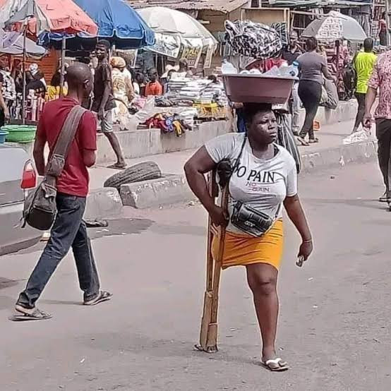 Amputee Street Hawker Apologizes To Nigerians; Accuses Her Grandmother Of Blackmail For Money