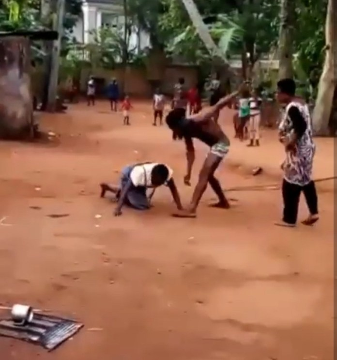 Young Man Filmed Flogging And Kicking An Elderly Woman In Anambra (Video)