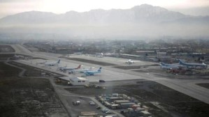 Afghan police return to work manning checkpoints alongside Taliban security at Kabul airport