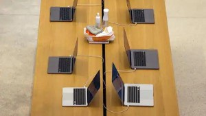 A table display of MacBook laptop computers at an Apple store (Bloomberg)