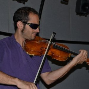 PDF  Evaluating violin quality  Player    Figure 2 4 One of the violinists that took part in the third study  wearing  dark