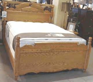 Wooden Bed Frame With Mattress And Box Spring Displayed In A Furniture