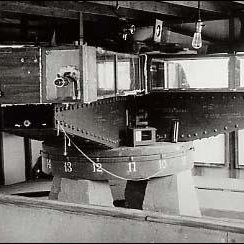 Figure 6. Dayton Miller's light-beam interferometer, at 4.3 meters across, was the largest and most sensitive of this type of apparatus ever constructed, with a mirror-reflected round-trip light-beam path of 64 meters. It was used in a definitive set of ether-drift experiments on Mt. Wilson, 1925-1926. Protective insulation is removed in this photograph, and windows were present all around the shelter at the level of the interferometer light-path. [8]