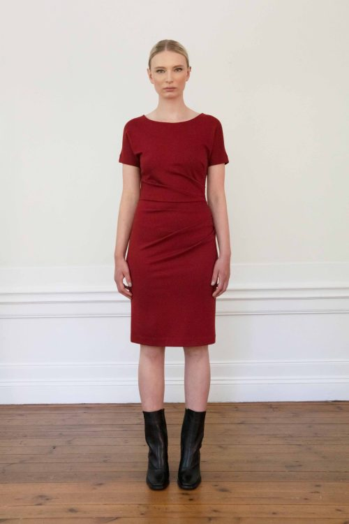 Girl wearing eve ecovero dress in color merlot