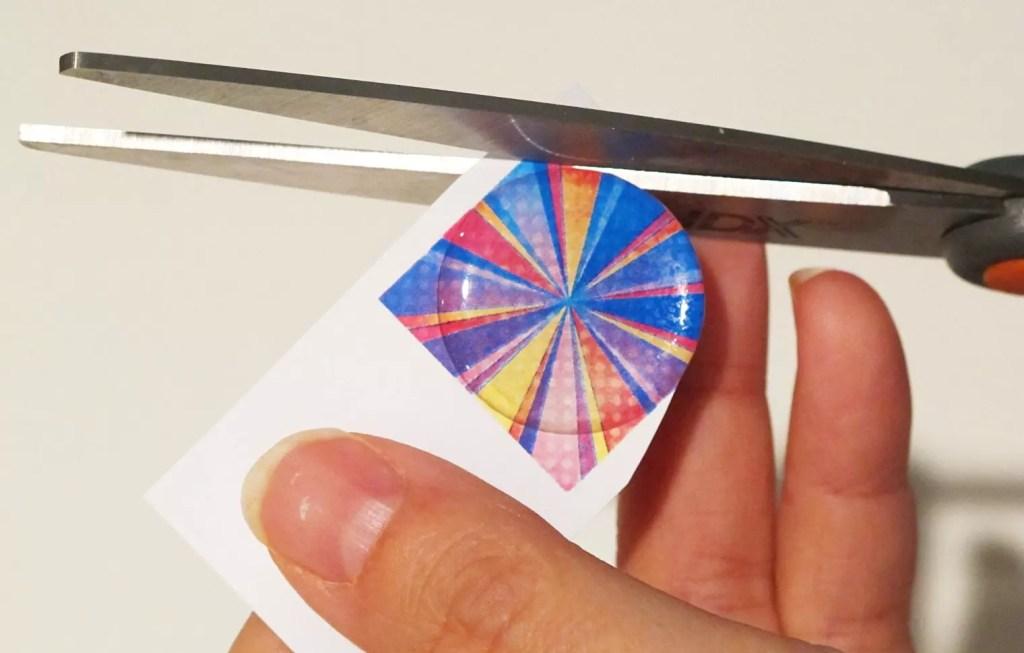 trim paper near sticker edge