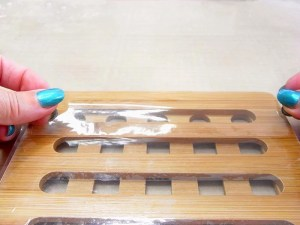 place packing tape on trivet holds