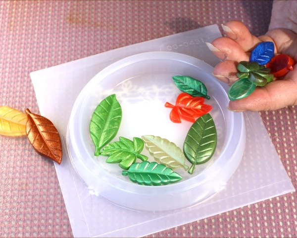 placing leaves in a plastic mold