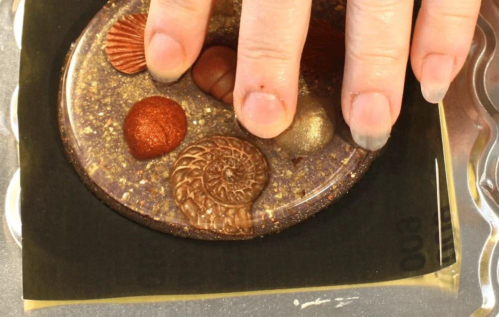 sanding a resin coaster on wet/dry sandpaper