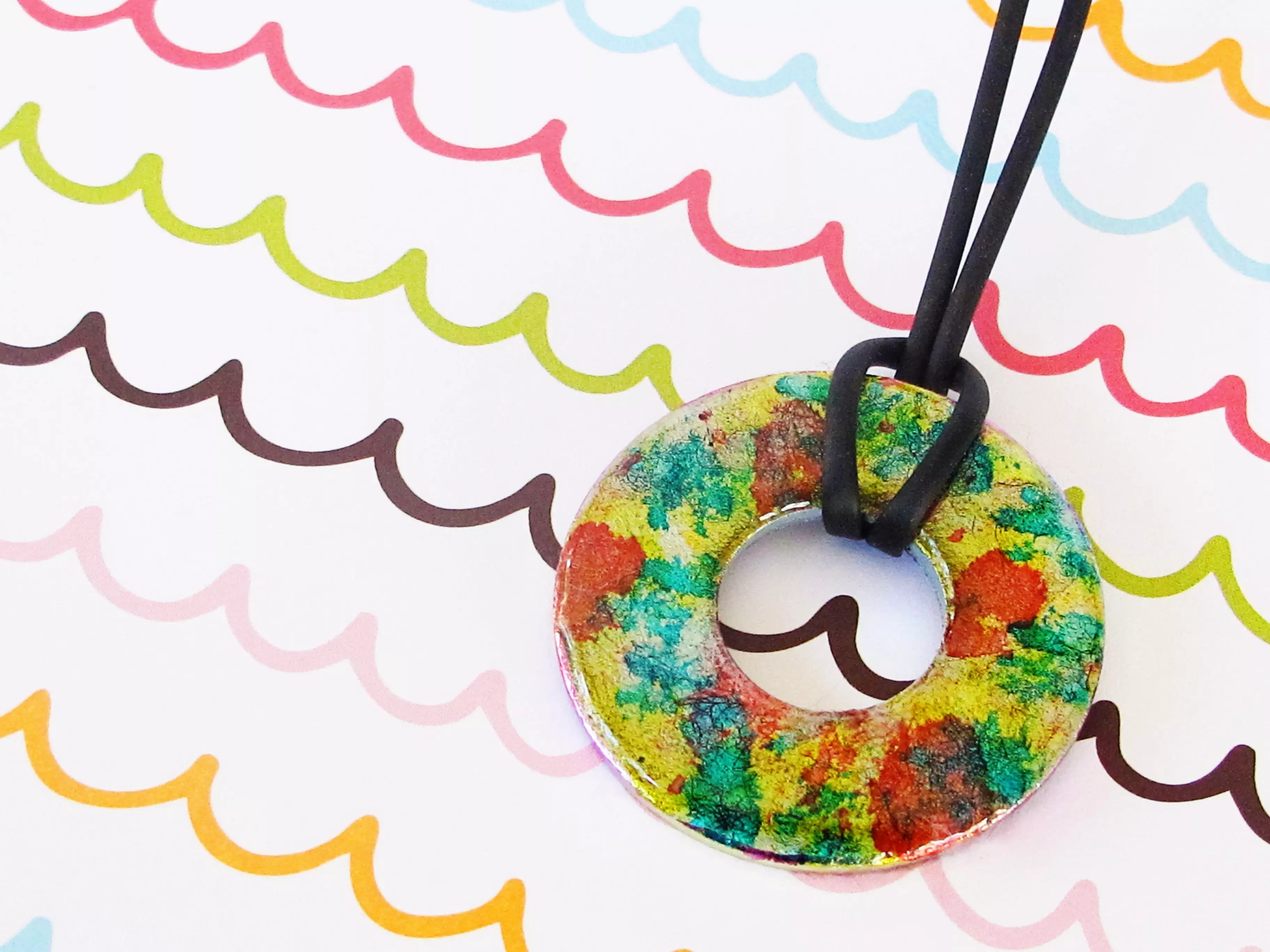 Washer pendant with a resin glaze