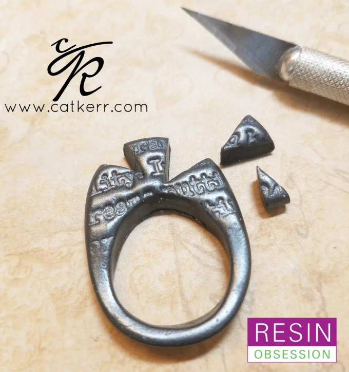 trimming pieces from polymer clay ring