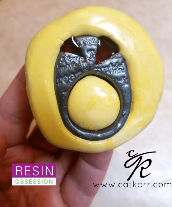 resin and polymer clay ring in a silicone mold