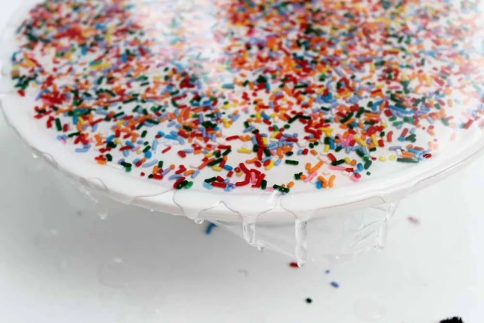 resin and sprinkles on a cupcake stand